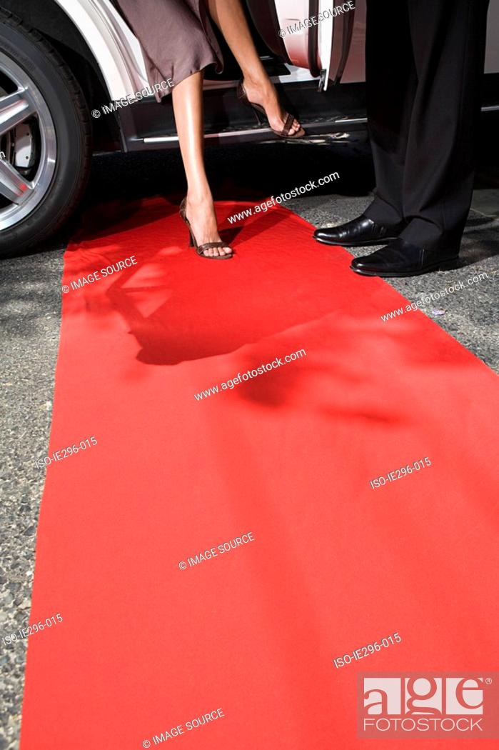 Stock Photo: Stepping onto red carpet.