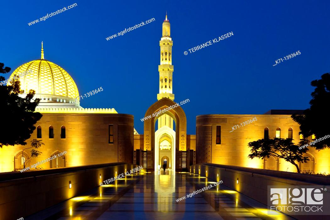 Stock Photo: The Grand Mosque illuminated at night in Muscat, Oman.