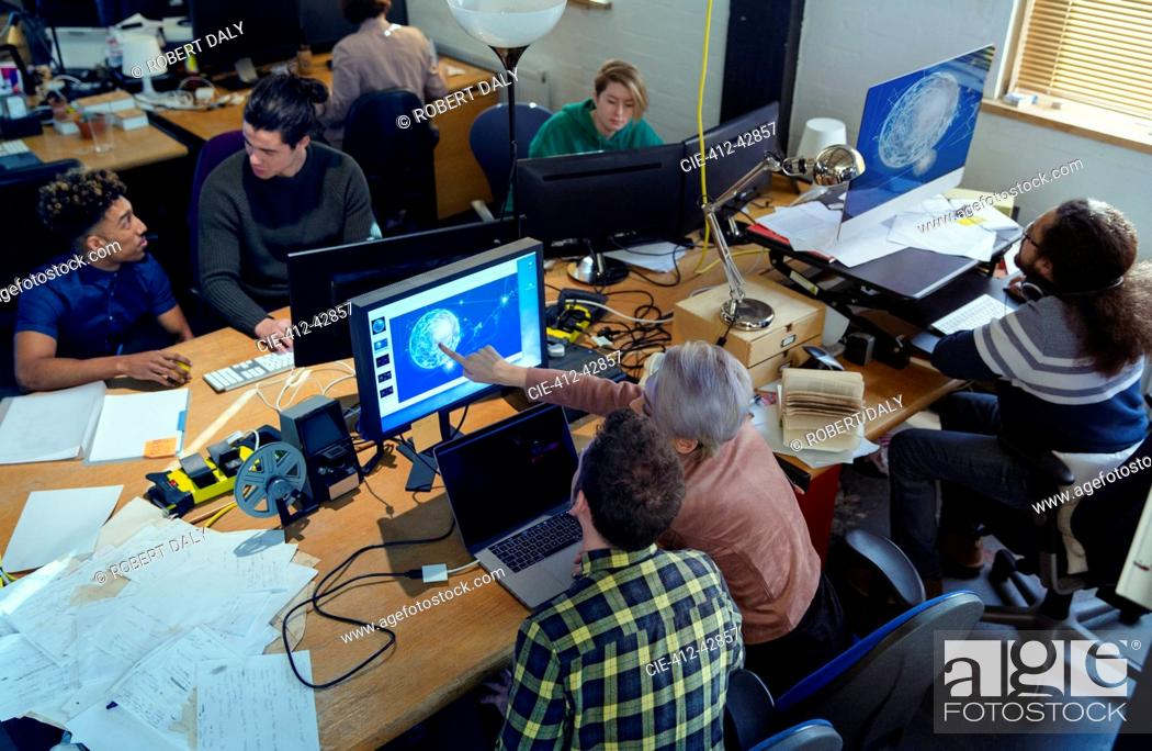 Stock Photo: Creative designers working, meeting n open plan office.