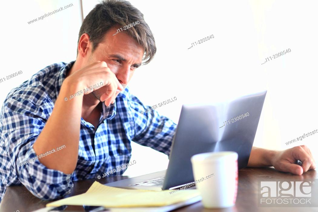 Stock Photo: Man working with laptop.
