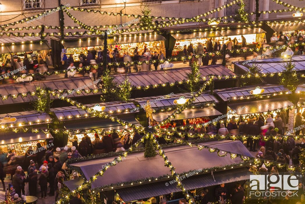 Stock Photo: Austria, Salzburgerland, Salzburg, Christmas Market, Residenzplatz, elevated view, dusk.