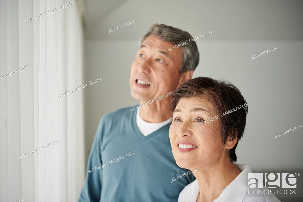 Stock Photo: Japanese senior couple in the living room.