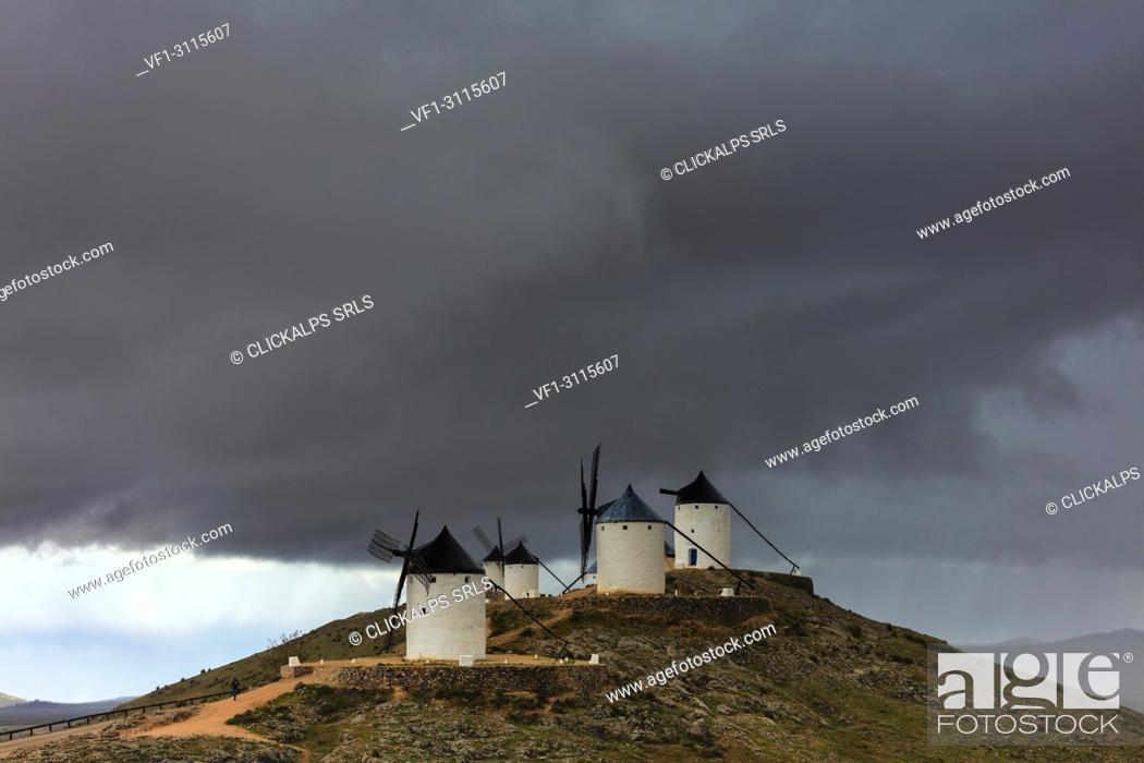 Stock Photo: Storm clouds on windmills of Consuegra, Don Quixote route, Toledo province, Castile-La Mancha region, Spain.