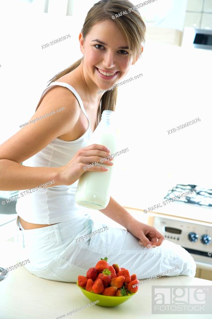 Stock Photo: woman drinking fresh milk.