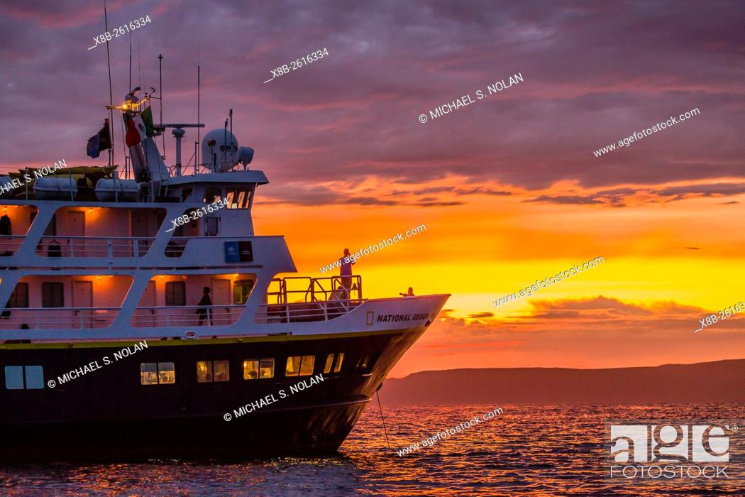 Stock Photo: The Lindblad Expeditions ship National Geographic Sea Lion at sunset off Isla Ildefonso, Baja California Sur, Mexico.