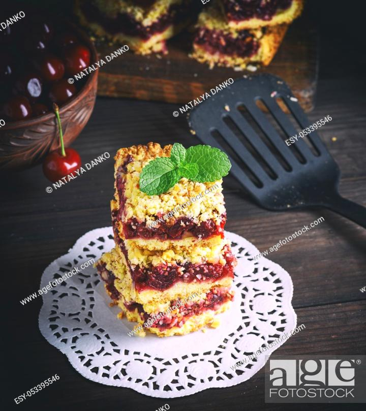 Photo de stock: stack of baked crumble cake with cherry, top view.