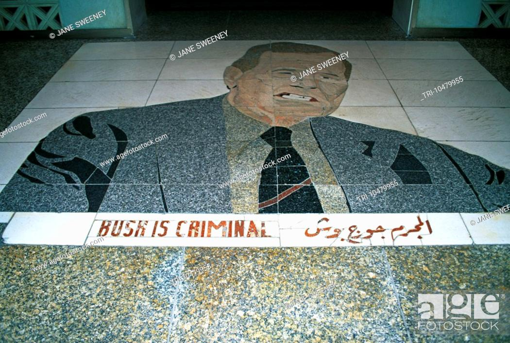 Stock Photo: Baghdad Iraq El Rashid Hotel Floor Tiles Picture Of President Bush bush Is Criminal Written.