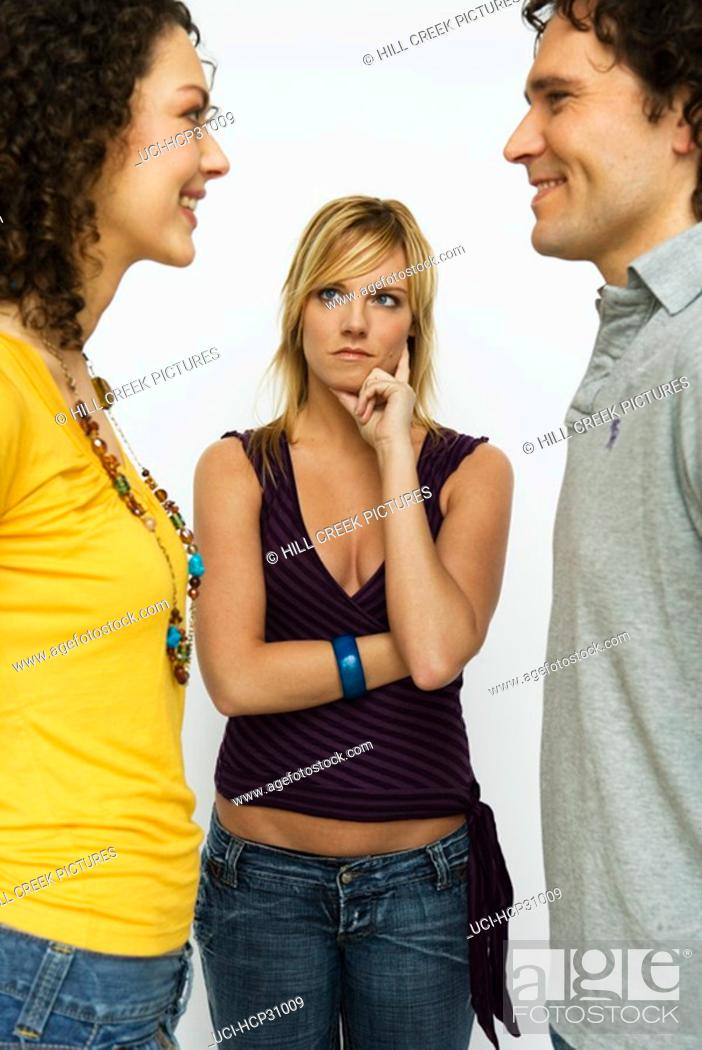 Stock Photo: Young woman examining young couple.