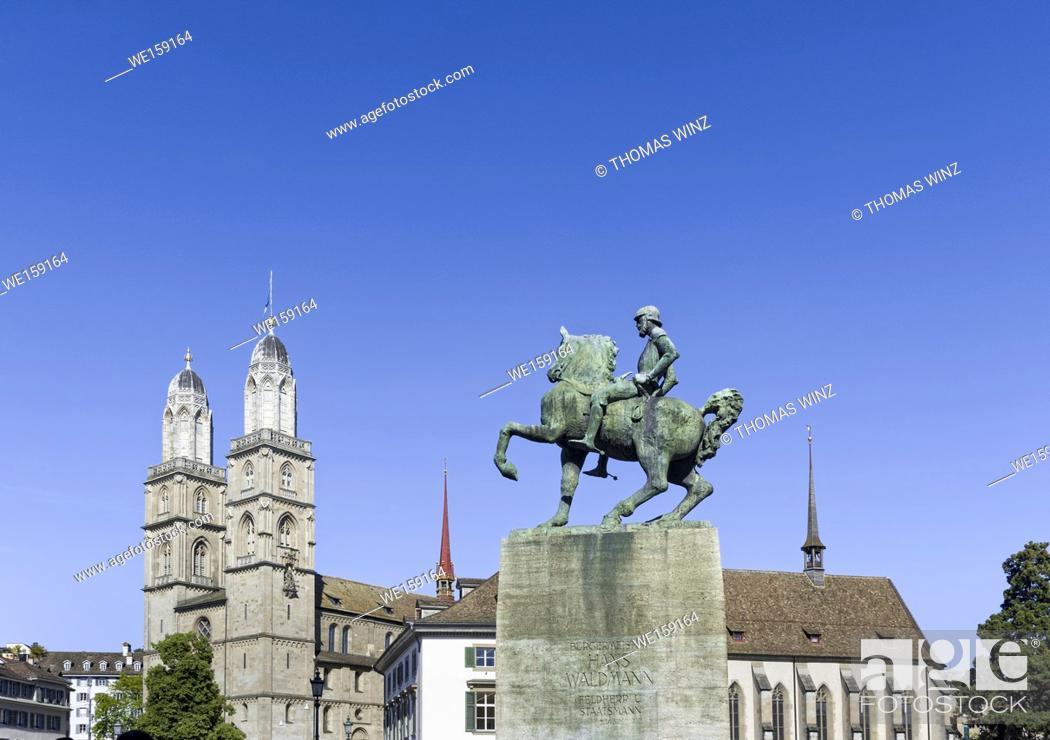 Stock Photo: Grossmünster church and Hans Waidmann Statue at Münster bridge in Zurich , Switzerland.