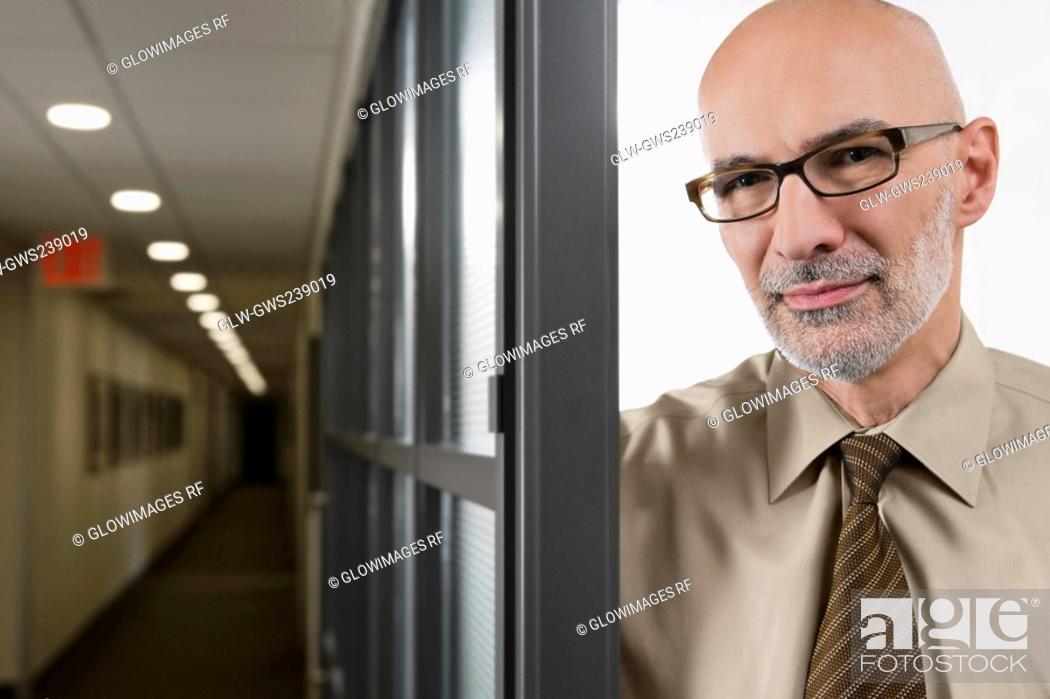 Stock Photo: Portrait of a businessman smirking.