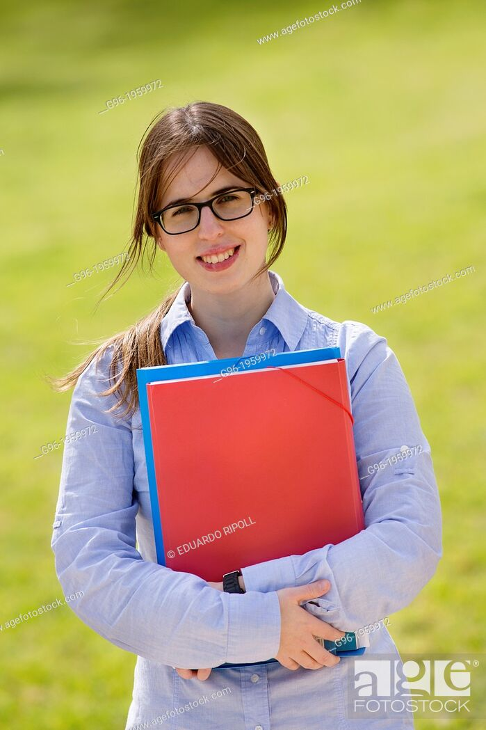 Stock Photo: Young student girl at the park with books.