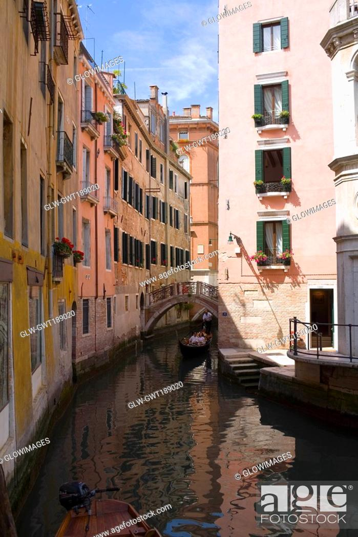 Stock Photo: Buildings along a canal, Venice, Italy.