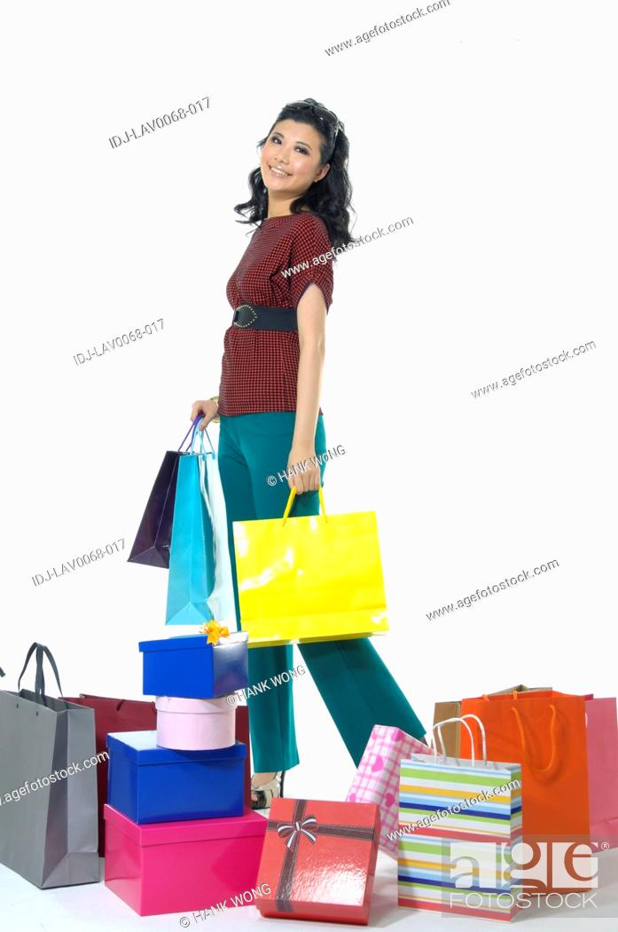 Stock Photo: Woman with gifts and shopping bags.