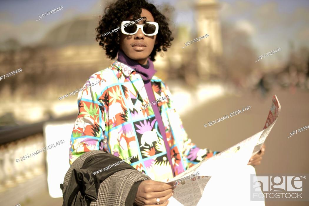Stock Photo: young fashion model man with city map, in Paris, France.