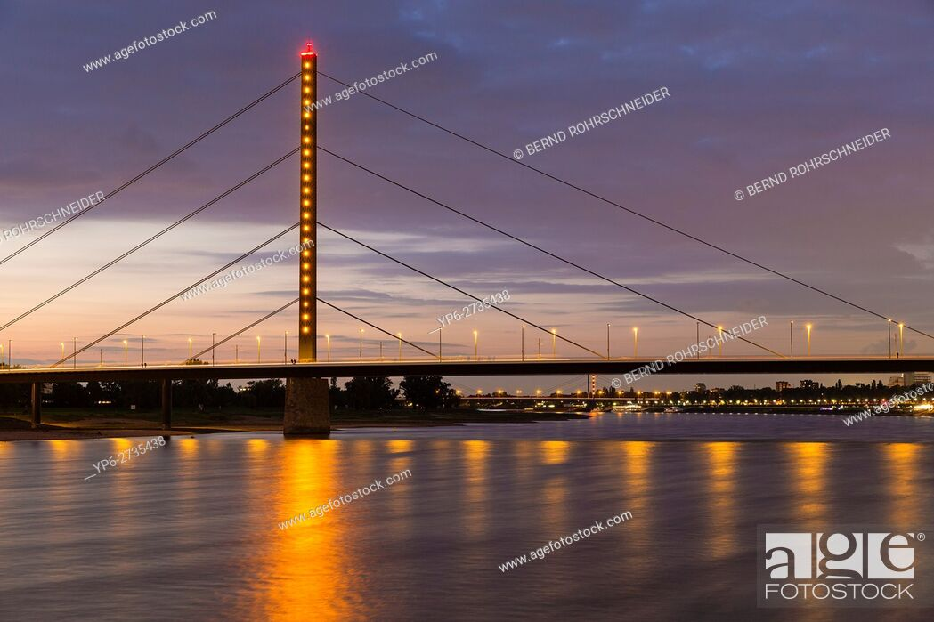 Stock Photo: Rhine with bridge at dusk, Düsseldorf, North Rhine-Westphalia, Germany.