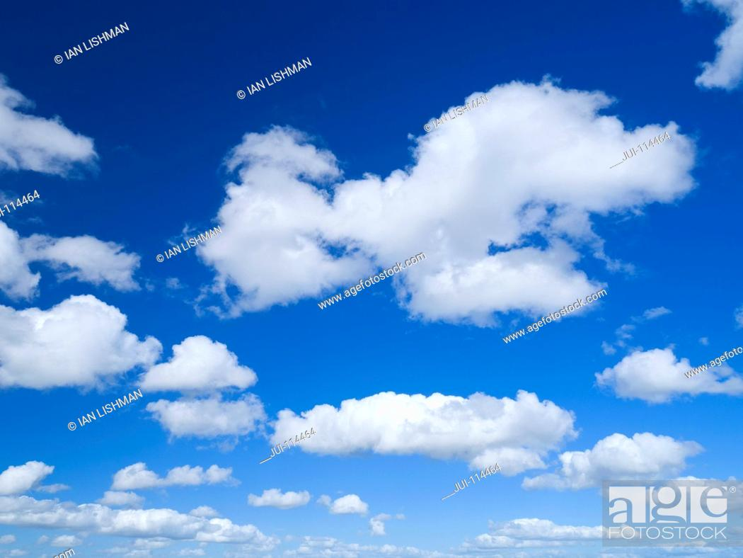 Stock Photo: White Clouds Against Blue Summer Sky.