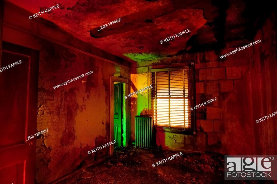 Stock Photo: Light painting of an old room of an abandoned haunted hotel, Stanford, Texas.