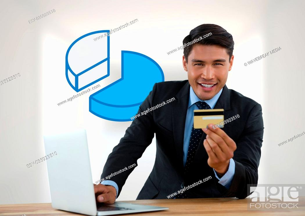 Stock Photo: Businessman with laptop at desk with diagram of pie chart and bank card.