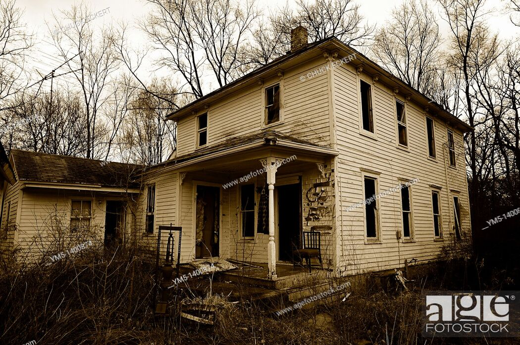 Stock Photo: Run down deserted farm house.