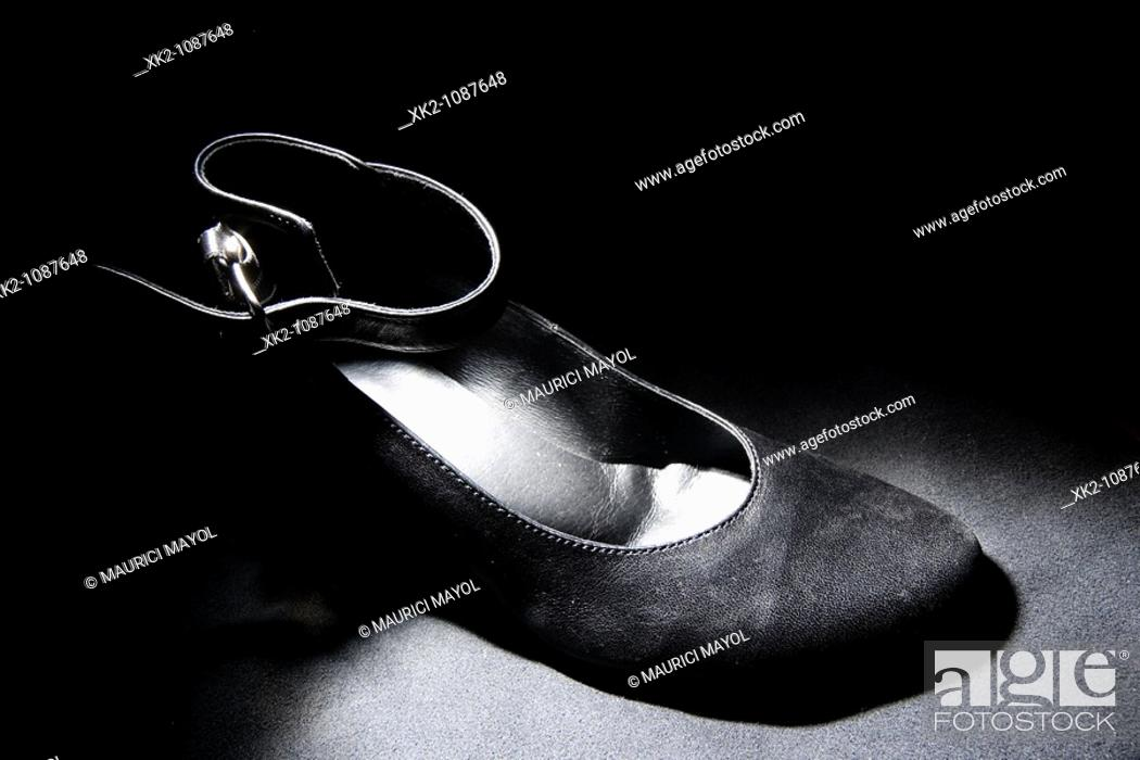 Stock Photo: detail of elegant high heels shoe, great illumination.
