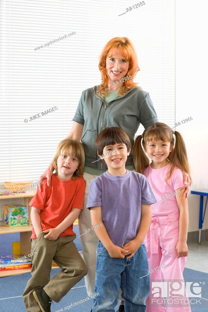 Stock Photo: Teacher with students 3-7, smiling, portrait.