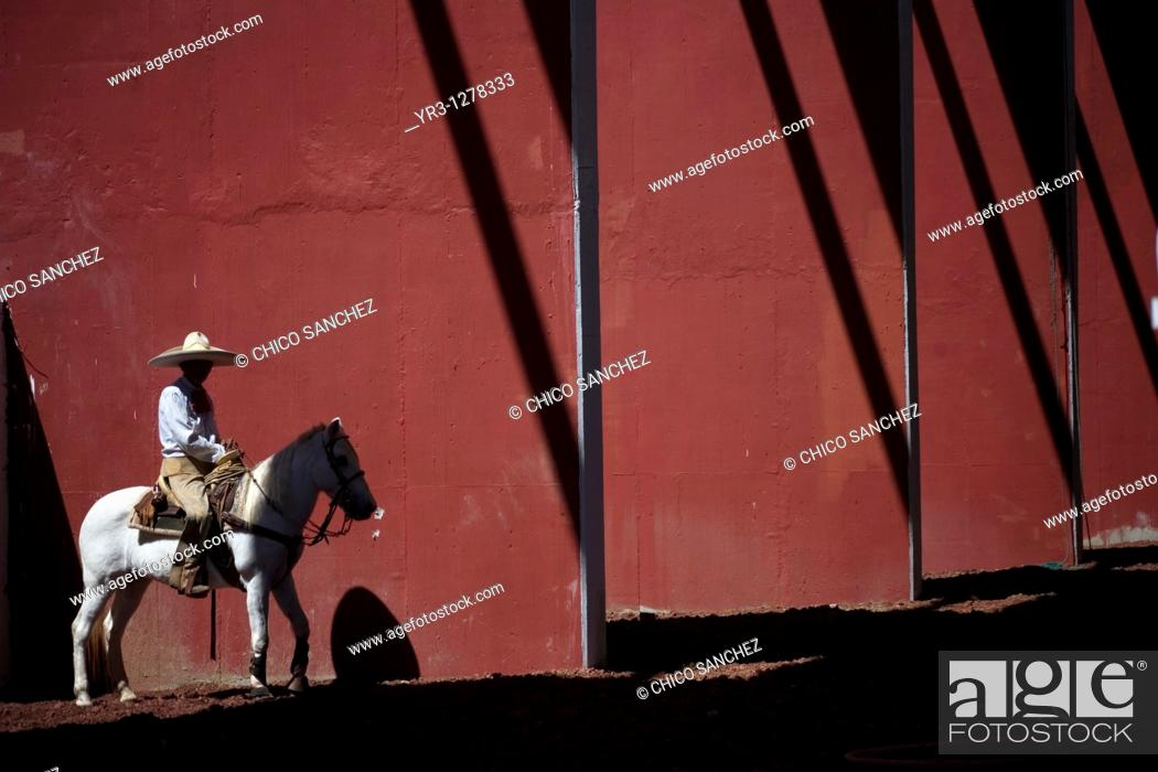 Stock Photo: A Mexican charro ride his horse at the National Charro Championship in Pachuca, Hidalgo State, Mexico. Escaramuzas are similar to US rodeos.