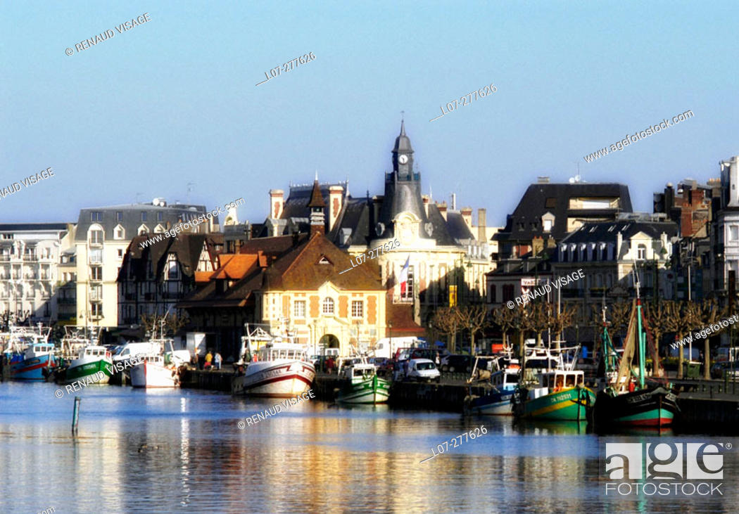 Stock Photo: Fishing boats in front of the town. Trouville. Normandy, France.