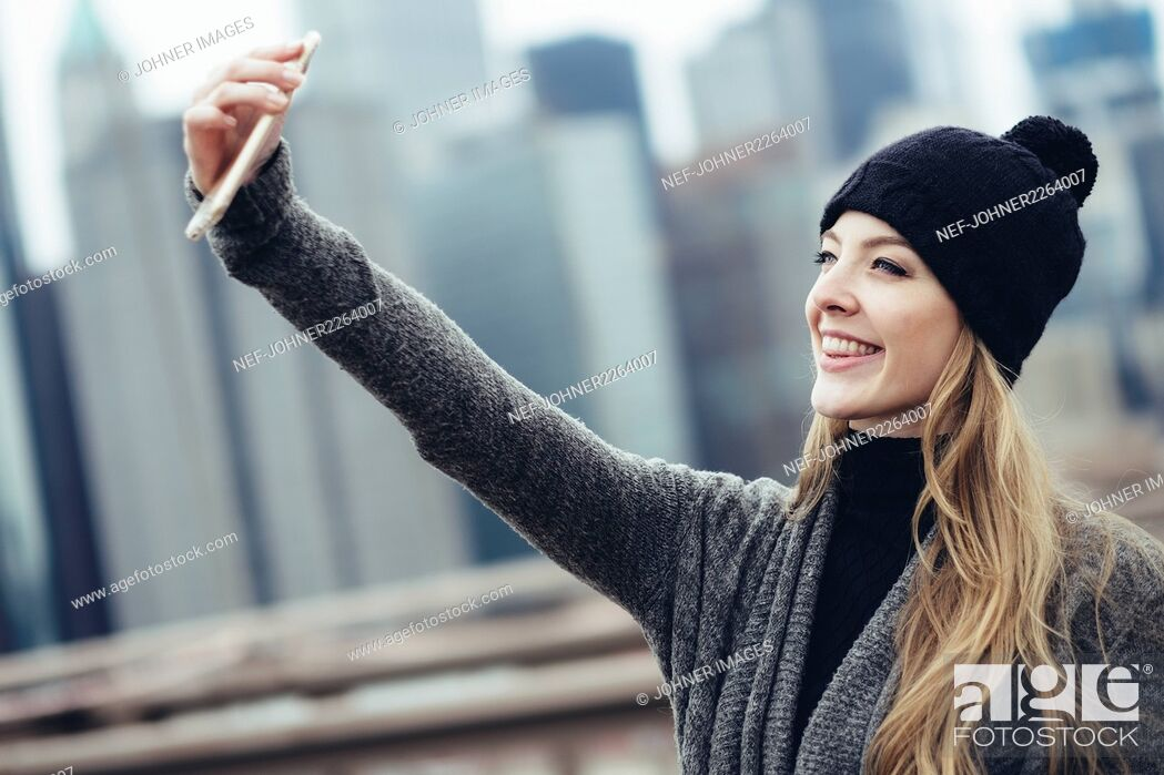 Stock Photo: Young woman taking selfie.