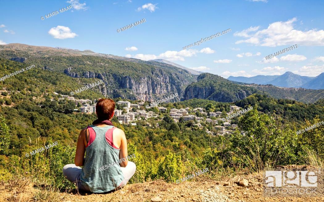 Stock Photo: Greece, Epirus, Zagori, Female hiker admiring forest surrounding village in¶ÿVikos-Aoos¶ÿNational Park during summer.
