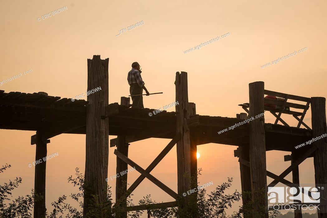 Stock Photo: Sunrise at U Bein Teak Bridge, Amarapura, Myanmar.