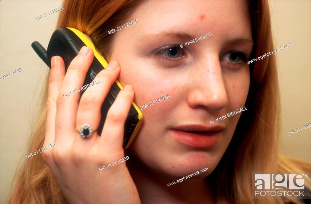 Stock Photo: Teenage girl talking on mobile phone,.