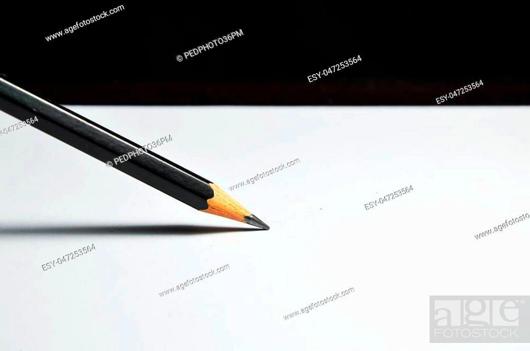 Stock Photo: pencil write on white paper.