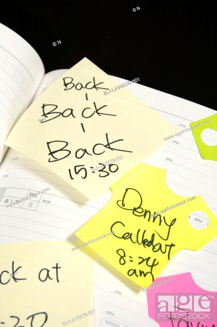 Stock Photo: Adhesive notes stuck on a diary.