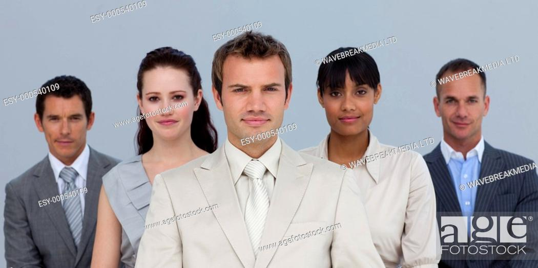 Stock Photo: Confident multi-ethnic business team in front of the camera.