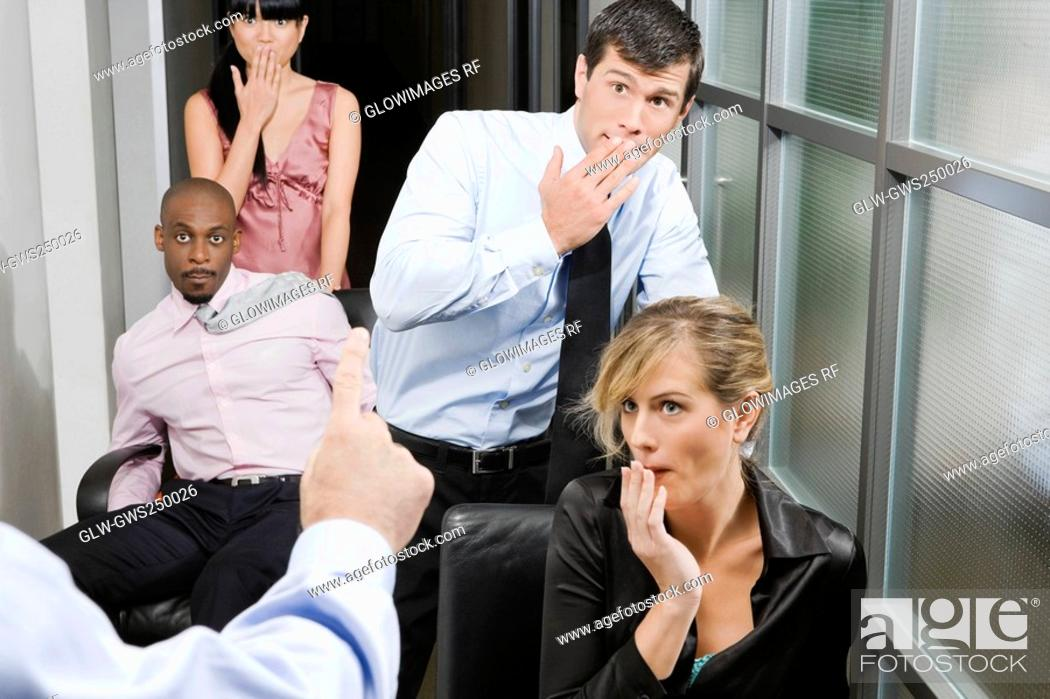 Stock Photo: Office workers being scolded by their boss.
