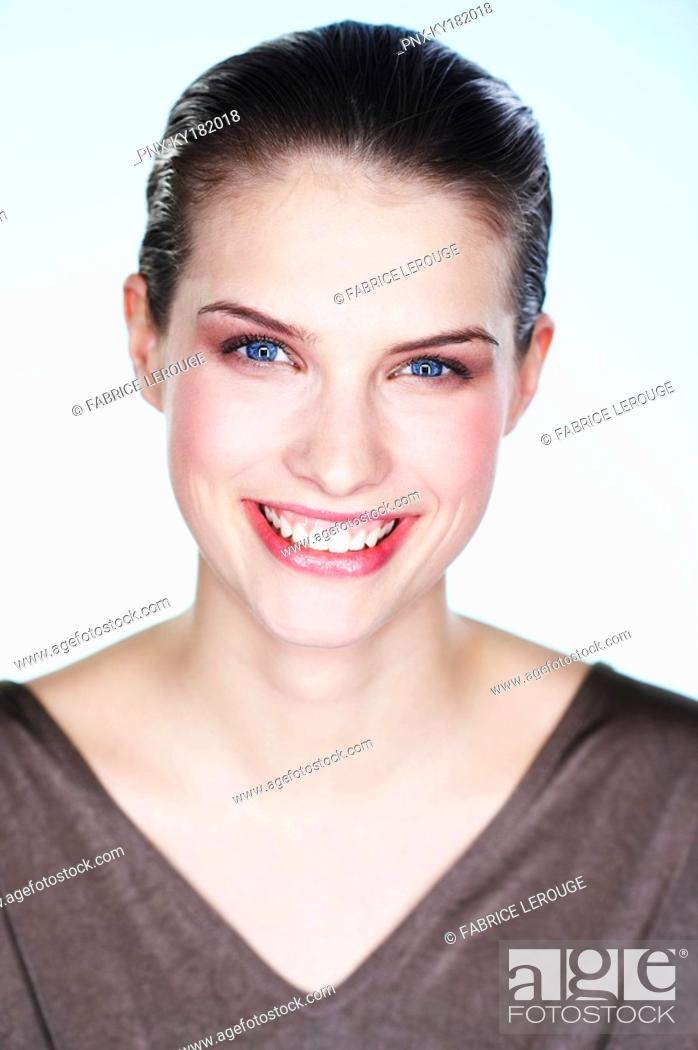 Stock Photo: Portrait of smiling young woman.