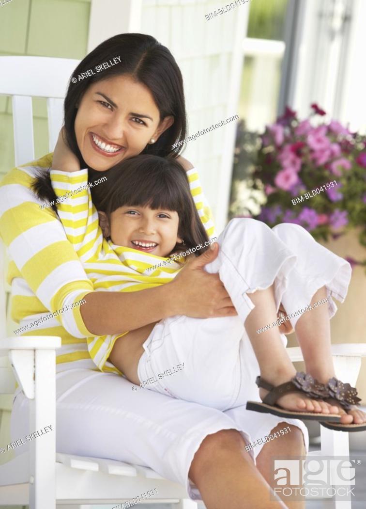 Stock Photo: Hispanic mother and daughter hugging.