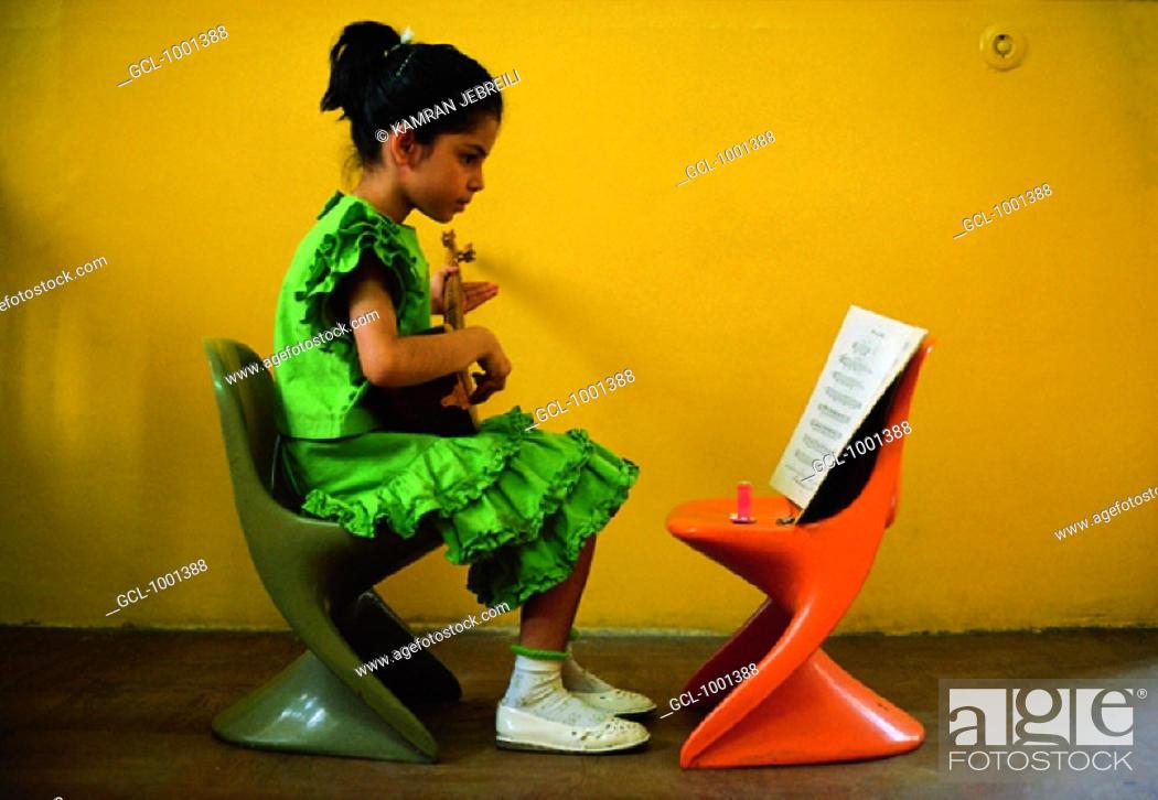 Stock Photo: Iranian girl playing the Oud.