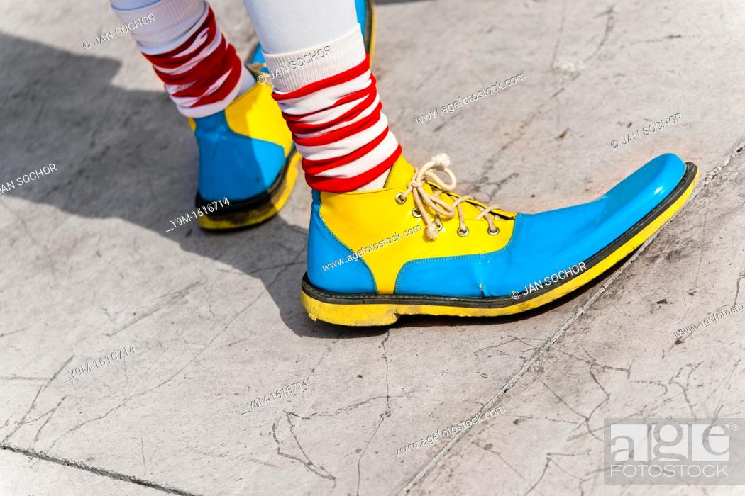 Stock Photo: A clown wears oversized multi colored shoes during the Clown Congress in San Salvador, El Salvador, 18 May 2011  The clown performance is considered a regular.
