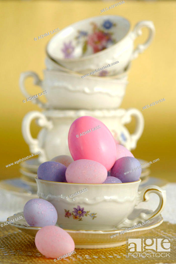Stock Photo: Easter eggs and coffee cups.