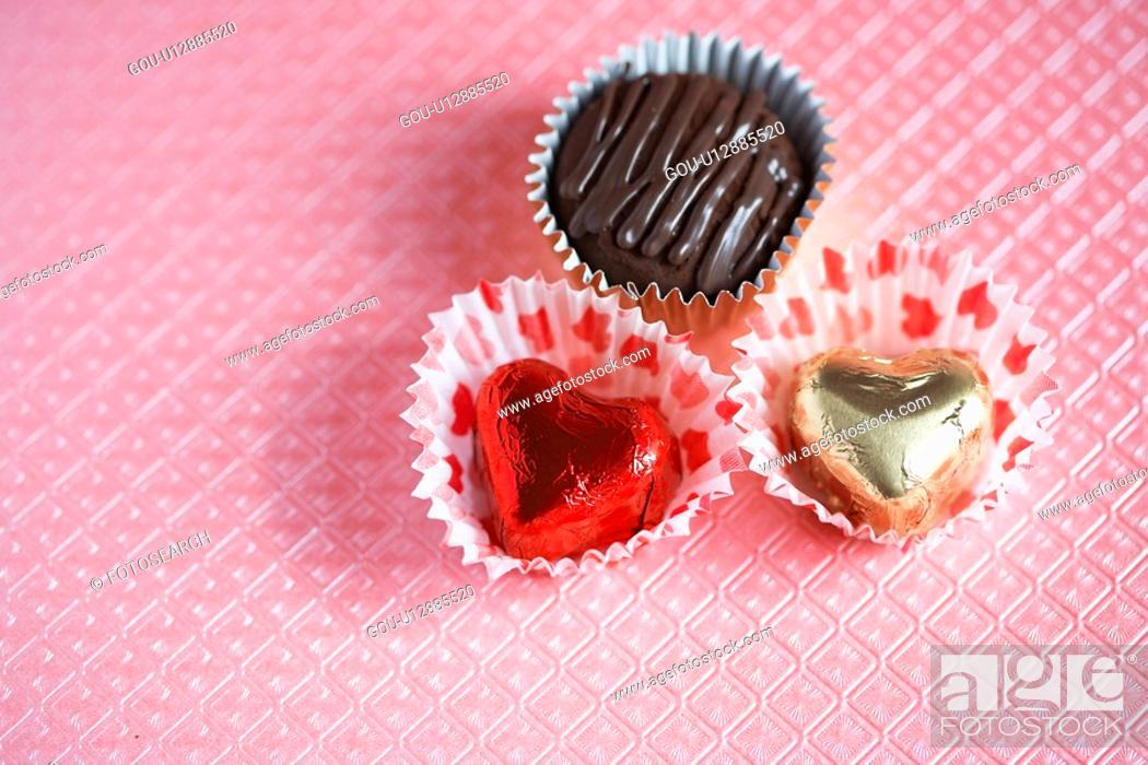 Stock Photo: Three chocolates (close-up).