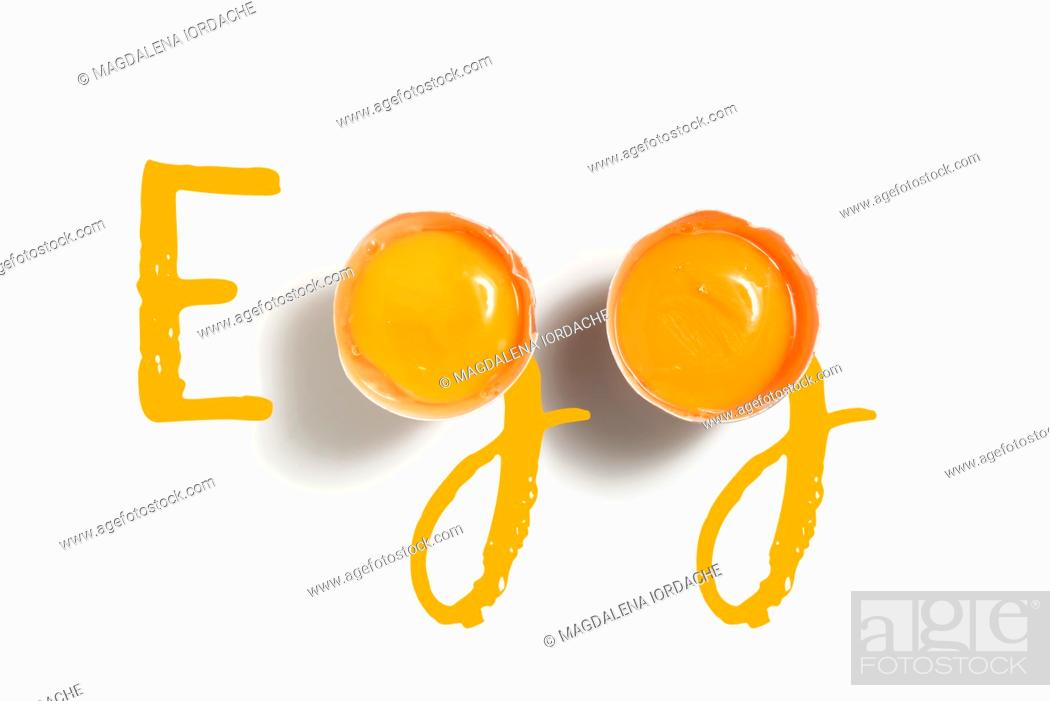 Imagen: Word Egg Written With 2 Egg Yolks On White Table.