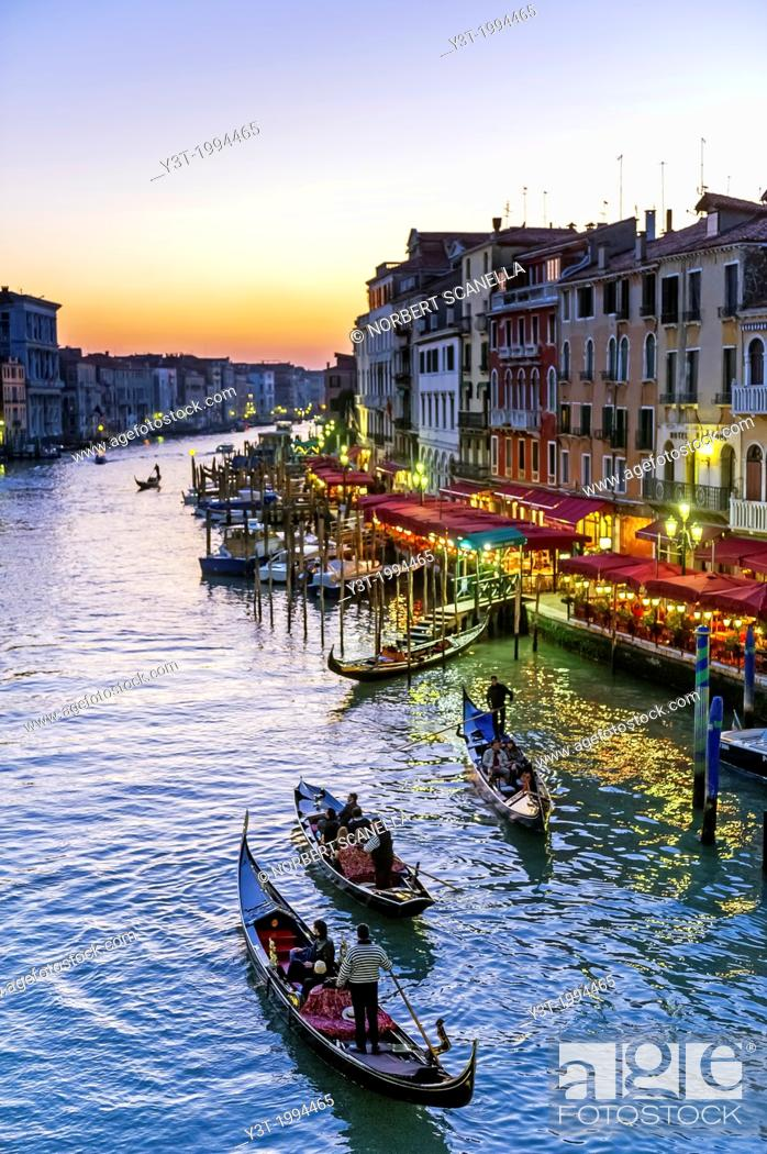 Stock Photo: Europe, Italy, Veneto, Venice, classified as World Heritage by UNESCO. Gondola in the Grand Canale at sunset.