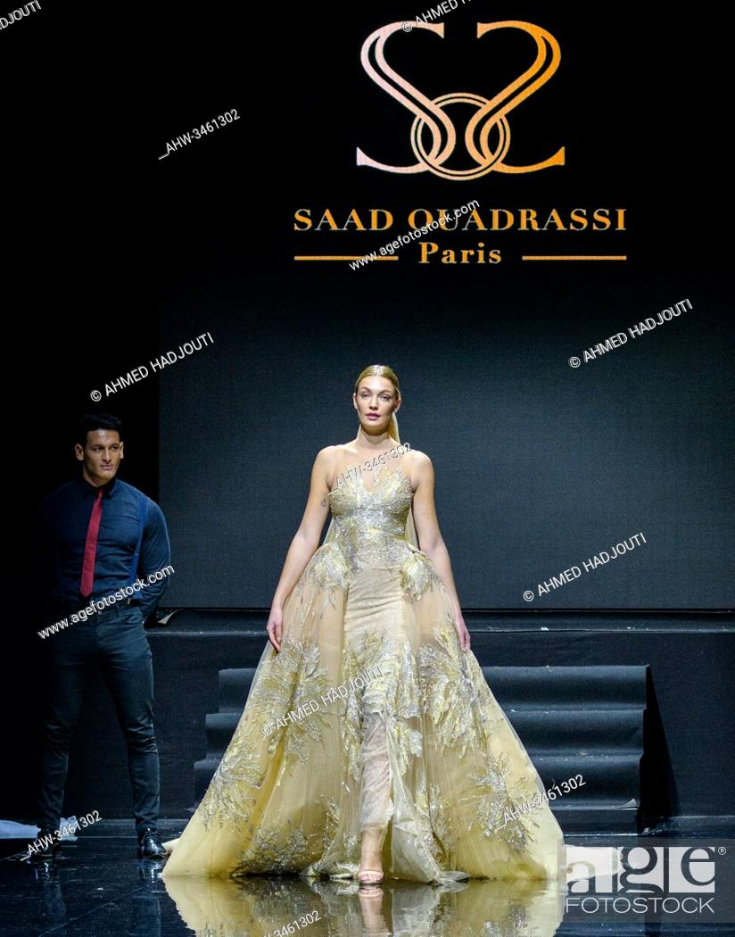 Stock Photo: PARIS, FRANCE - JANUARY 20: A model walks the runway during the Saad Ouadrassi Show As part of the Oriental Fashion show during the Paris Fashion Week on.