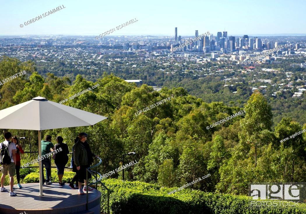 Stock Photo: Australia, Queensland, Brisbane. Tourists looking out over the city of Brisbane from the summit of Mt Coot-Tha.