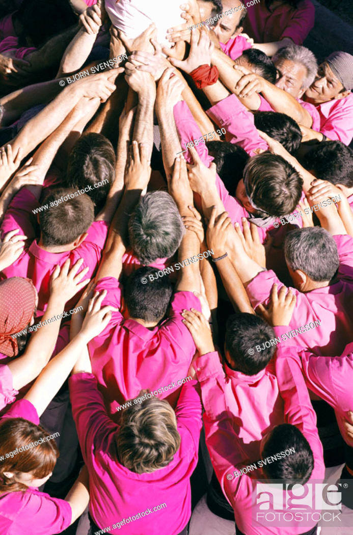 Stock Photo: 'Castellers' building human towers, a Catalan tradition. Sant Pere de Ribes. Barcelona province, Spain.