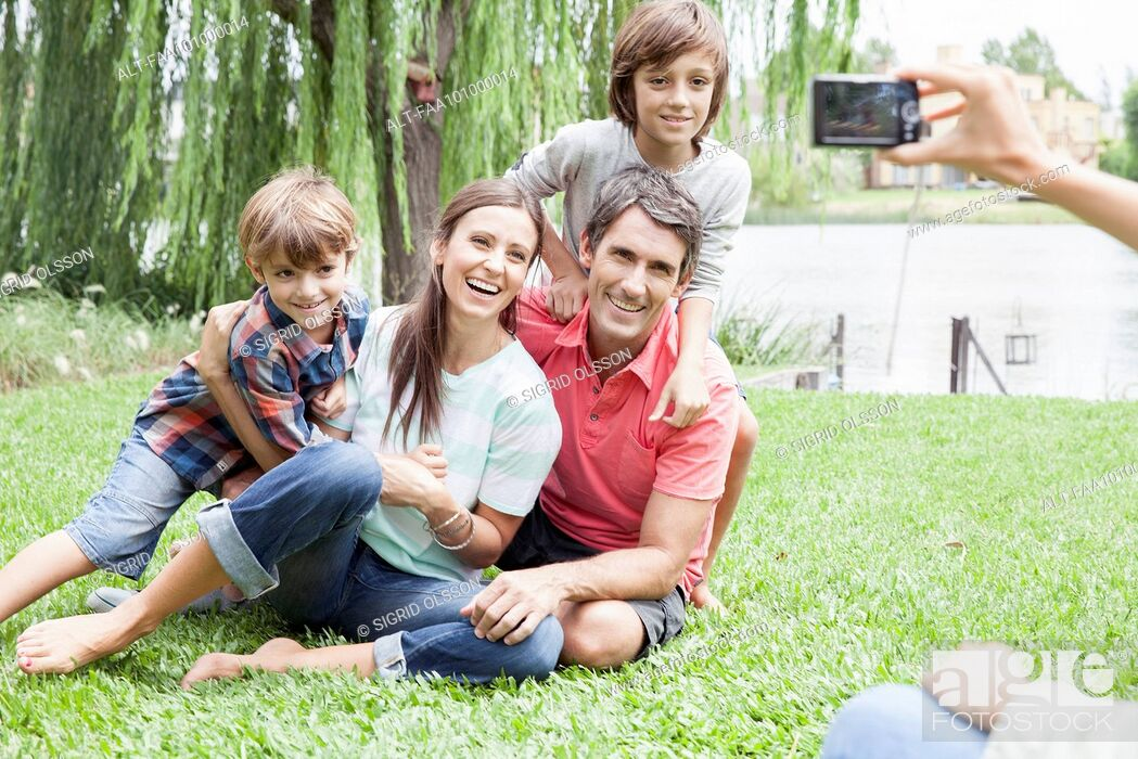 Stock Photo: Using digital camera to photograph family, personal perspective.