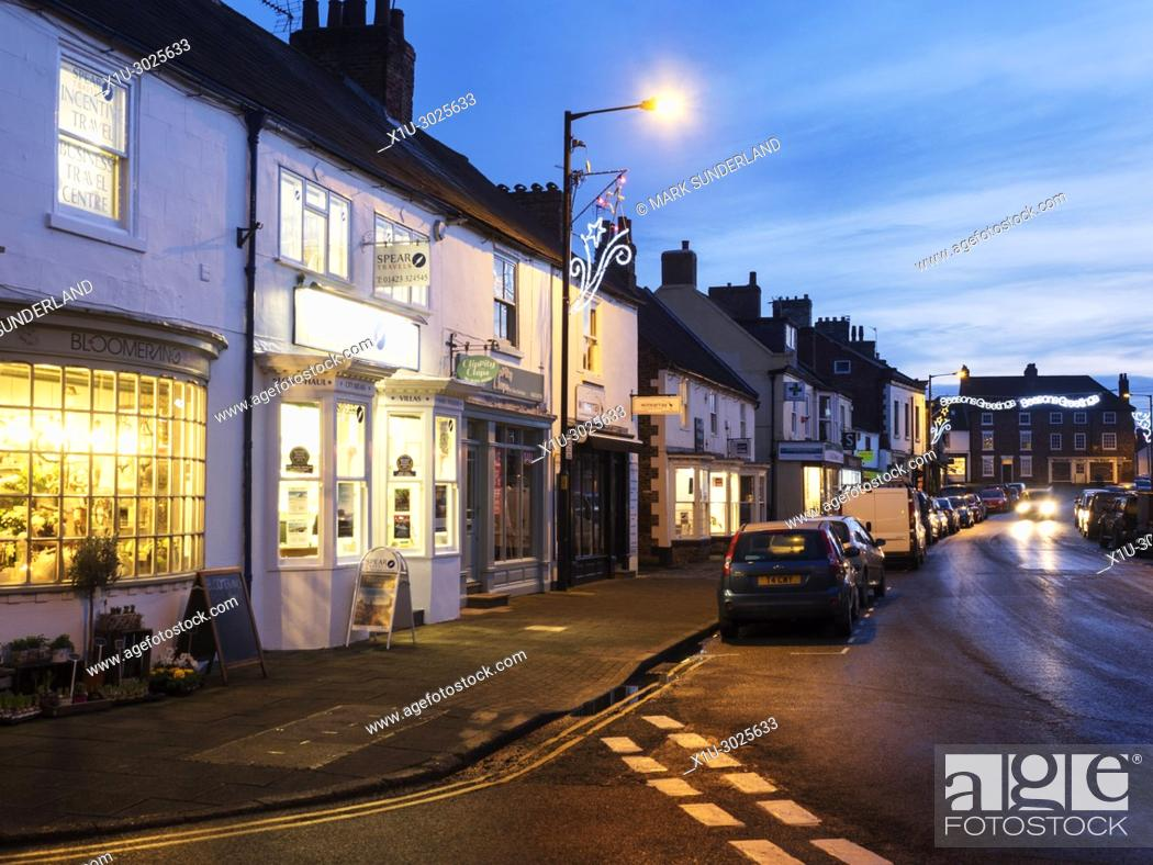 Stock Photo: The High STreet at Dusk at Christmas Boroughbridge North Yorkshire England.