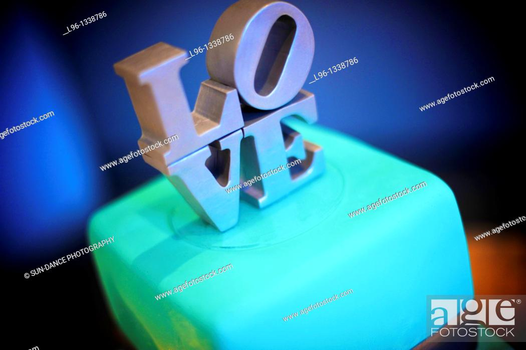 Stock Photo: Blue wedding cake with LOVE topper.