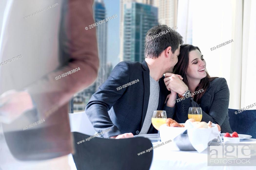 Stock Photo: Romantic young couple at breakfast in hotel restaurant.